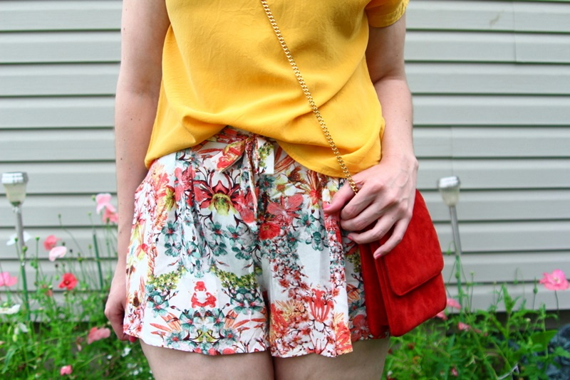 outfit detail floral shorts summer, yellow blouse, red purse, colourpop bossy lippie stix, pixie hair cut, lulus white sandals