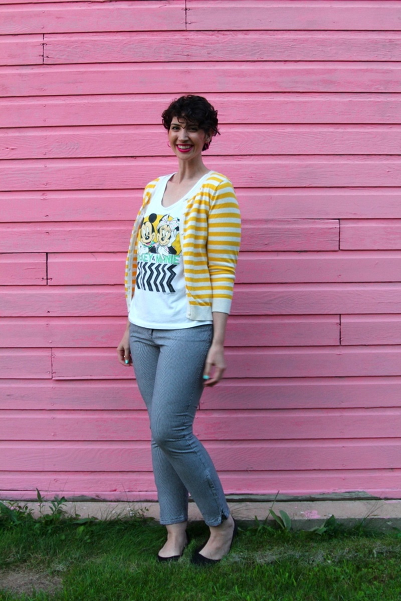 how to style houndstooth pants outfit unexpected pattern mixing yellow striped H&M cardigan, vintage minnie and mickey mouse graphic tshirt, curly hair, YSL fuchsia lipstick, black walmart flats