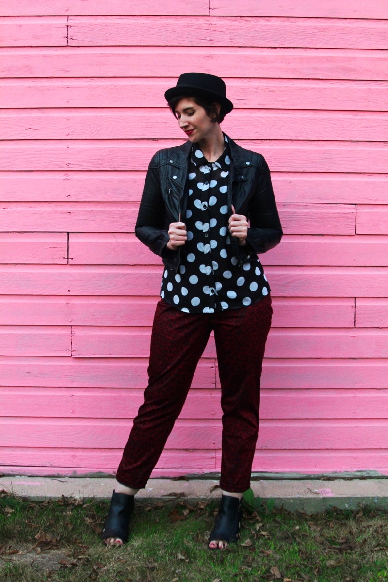 the outfit repeater hannah rupp, thrifted polka dot button up, thredUP red leopard print pants, H&M leather jacket, seven dials shoes black cutout booties, asos pork pie hat, colourpop lippie stix lbb